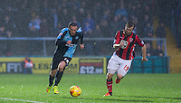 Michael Harriman of Wycombe Wanderers & Laurence Wilson of Morecambe chase the ball during the Sky Bet League 2 match between Wycombe Wanderers and Morecambe at Adams Park, High Wycombe, England on 2 January 2016. Photo by Andy Rowland / PRiME Media Images