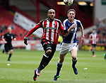 Leon Clarke of Sheffield United tussles with Lloyd Allinson of Chesterfield during the English League One match at Bramall Lane Stadium, Sheffield. Picture date: April 30th, 2017. Pic credit should read: Jamie Tyerman/Sportimage