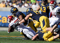 California defenders tackle Marcus Mason of Washington State during the game at Memorial Stadium in Berkeley, California on October 5th, 2013.  Washington State defeated California, 44-22.
