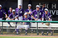 The High Point Panthers bench watches the game against the Coastal Carolina Chanticleers at Willard Stadium on March 15, 2014 in High Point, North Carolina.  The Chanticleers defeated the Panthers 1-0 in the first game of a double-header.  (Brian Westerholt/Four Seam Images)