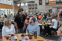 NWA Democrat-Gazette/FLIP PUTTHOFF<br /> WELCOME TEACHERS<br /> Sharon Lewis (center), assistant principal at Central Park and Willowbrook elementary schools in Bentonville, visits with Willowbrook teachers Stacey Schoeppler and Matt Land during the New Teachers Luncheon held Tuesday at Bentonville High School. Teachers and administrators heard words of encouragement from school officials and business representatives that work with the school district. Drawings for prizes were also held.