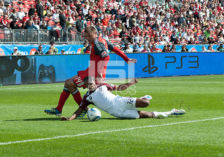 17 September 2011:  Colorado Rapids defender Miguel Comminges #32 and Toronto FC forward Danny Koevermans #14 in action during an MLS game between the Colorado Rapids and the Toronto FC at BMO Field in Toronto, Ontario Canada..Toronto FC won 2-1.