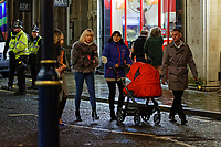 Pictured: A woman pushing a pushchair. Sunday 31 December 2017 and 01 January 2018<br /> Re: New Year revellers in Wind Street, Swansea, Wales, UK