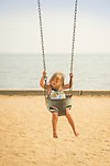Surf Club Town Beach. Toddler in swing.