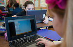 WINSTED,  CT-122216JS06-Ivy Davie, right, a fifth grade student at Pearson Middle School in Winsted, works on the new computerized math program called ST Math which uses spatial temporal reasoning to help solve math problems at the school on Thursday,  Jim Shannon Republican American