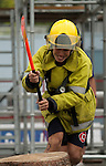 Vancouver, Canada, Aug 6th 2009.  World Police and Fire Games, Ultimate Firefighter Competition. Competitor Leon L Berthelsen of the Western Australia Fire Brigade sets the axe into the log during the Weight and Strength Stage of the competition.  Photo by Gus Curtis