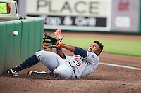 Lakeland Flying Tigers left fielder Christin Stewart (20) slides trying to catch a fly ball in foul territory during a game against the Clearwater Threshers on August 5, 2016 at Bright House Field in Clearwater, Florida.  Clearwater defeated Lakeland 3-2.  (Mike Janes/Four Seam Images)