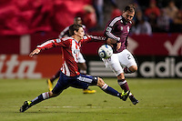 Colorado Rapids midfielder Jamie Smith (20) battles CD Chivas USA defender Ben Zemanski (21). The Colorado Rapids defeated CD Chivas USA 1-0 at Home Depot Center stadium in Carson, California on Saturday March 26, 2011...