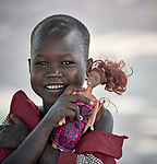 A girl holds a doll in the Loreto Primary School in Rumbek, South Sudan. While focused on educating girls from throughout the war-torn country, the school, run by the Institute for the Blessed Virgin Mary--the Loreto Sisters--of Ireland, also educates children from nearby communities.