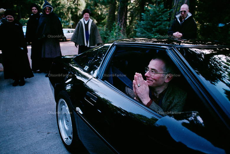 Leaving Shasta Abbey for another monastery, a Zen Buddhist monk clasps his hands through the open window of a car. The monastery near Mount Shasta opened in 1970 as a training site for monks.