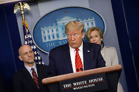 United States President Donald J. Trump speaks during a press briefing on the Coronavirus COVID-19 pandemic with members of the Coronavirus Task Force at the White House in Washington on March 19, 2020. At left is Stephen Hahn, Commissioner, US Food and Drug Administration (FDA) and at right is Dr. Deborah L. Birx, White House Coronavirus Response Coordinator.<br /> Credit: Yuri Gripas / Pool via CNP/AdMedia