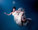 Amanda Nalley swims in her wedding dress.