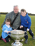 Mark, Eoin and Tara Dignam pictured with the Sam Maguire cup at Newtown Blues GAA club. Photo: Colin Bell/pressphotos.ie