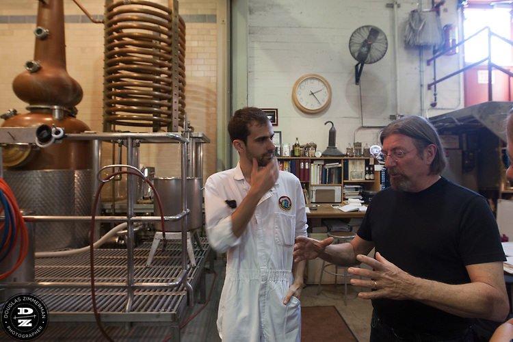 Keith Greggor, president and CEO of Anchor Brewers & Distillers talks with an employee at the Anchor Steam brewery in San Francisco, Calif.