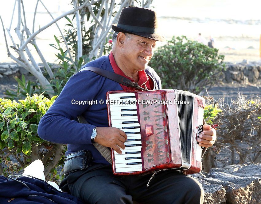LANZAROTE, CANARY ISLANDS - Busker in the beach resort of Costa Teguise during January 2016 in Lanzarote, Canary Islands<br /> <br /> Photo by Keith Mayhew