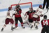 Makenna Newkirk (BC - 19), Maddie Hartman (NU - 27), Brittany Bugalski (NU - 39), Kenzie Kent (BC - 12) -  The Boston College Eagles defeated the Northeastern University Huskies 2-1 in overtime to win the 2017 Hockey East championship on Sunday, March 5, 2017, at Walter Brown Arena in Boston, Massachusetts.
