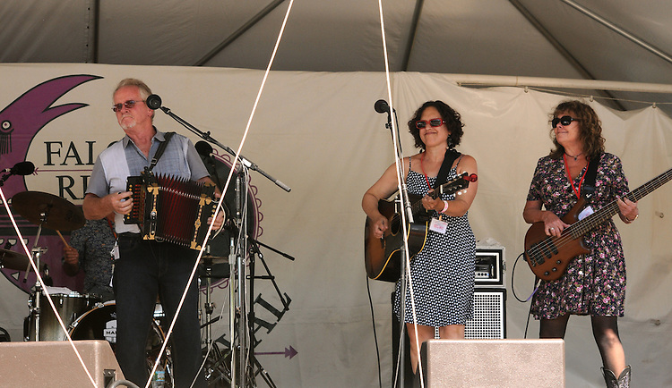 Jesse Lege, Erica Weiss, and Evelyn Schneider of Jesse Lege & Bayou Brew performing on the Main Stage at the Falcon Ridge Folk Festival, held on Dodd's Farm in Hillsdale, NY on Saturday, August 1, 2015. Photo by Jim Peppler. Copyright Jim Peppler 2015.