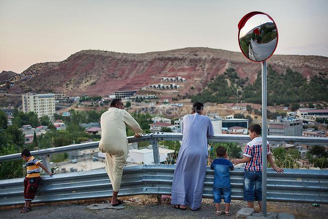 29/08/15. Shaqlawa, Iraq. -- Two friends originally from Falluja look at their new city at dusk.