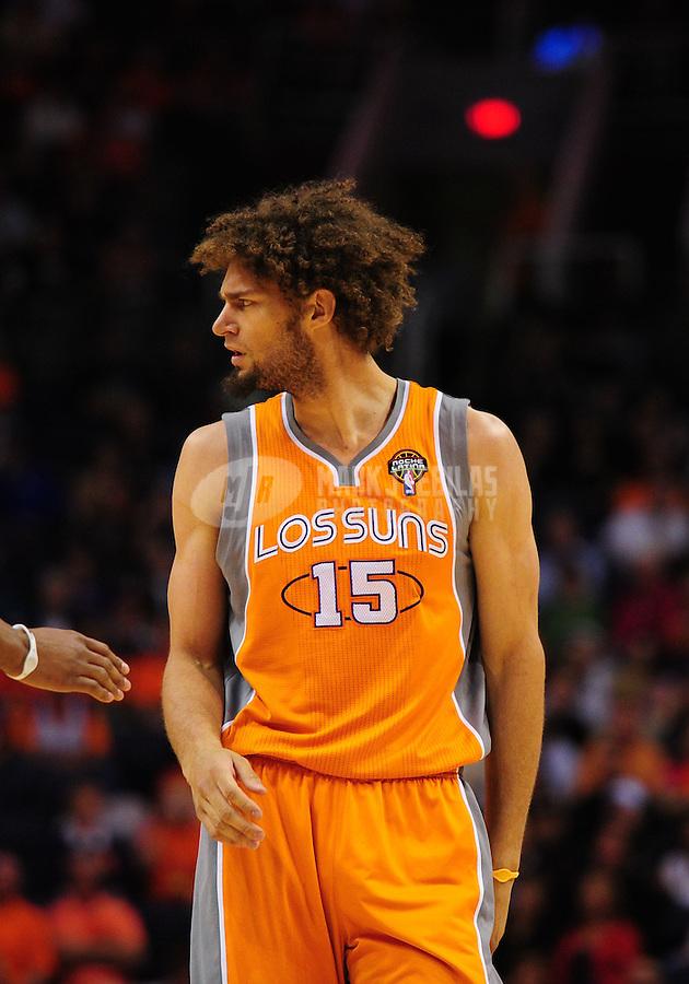 Mar. 25, 2011; Phoenix, AZ, USA; Phoenix Suns center (15) Robin Lopez against the New Orleans Hornets at the US Airways Center. The Hornets defeated the Suns 106-100. Mandatory Credit: Mark J. Rebilas-.