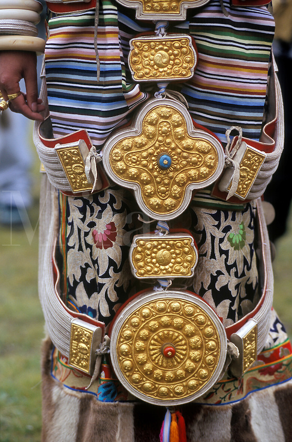 Detail of traditional female Khampa wearing gold & silver gau boxes at the Litang Horse Festival - Sichuan Province, China