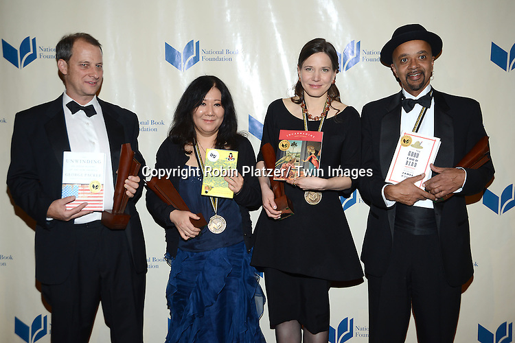 The winners, George Packer, Cynthia Kadohata, Mary Szybist and James McBrider attend the 2013 National Book Awards Dinner and Ceremony on November 20, 2013 at Cipriani Wall Street in New York City.