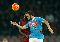 Napoli's Gonzalo Higuain jump for the ball with  AS Roma's Antonio Rudiger   during the  italian serie a soccer match,between SSC Napoli and AS Roma       at  the San  Paolo   stadium in Naples  Italy ,December 13, 2015