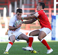 PICTURE BY ALEX WHITEHEAD/SWPIX.COM - Rugby League - Autumn International Series - Wales vs England - Glyndwr University Racecourse Stadium, Wrexham, Wales - 27/10/12 - England's Richard Myler is tackled by Wales' Mike Channing.