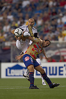 New England Revolution forward Ilija Stolica (9) and Monarcas Morelia defender Mauricio Romero (26) battle for a high pass. Monarcas Morelia defeated the New England Revolution, 2-1, in the SuperLiga 2010 Final at Gillette Stadium on September 1, 2010.