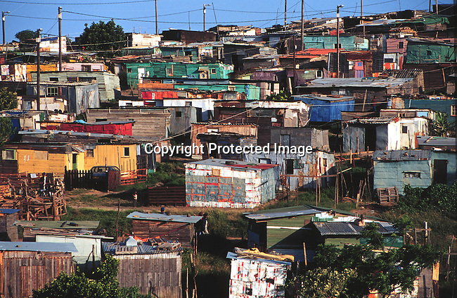 lssquat30137  .Industry. Housing. Home environments. Township. Duncan Village, a township outside of East London; shack; squatter camp;  Electricity. Poverty. .©Per-Anders Pettersson/iAfrika Photos