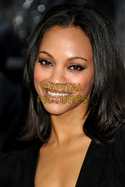 "ZOE SALDANA.""The Losers"" Los Angeles Premiere held at Grauman's Chinese Theatre, Hollywood, California, USA, .20th April 2010..portrait headshot black smiling make-up .CAP/ADM/BP.©Byron Purvis/AdMedia/Capital Pictures."
