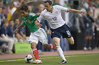 Fernando Arce holds off Ramiro Corrales. USA and Mexico tied, 2-2, in an international friendly at Reliant Stadium, Houston, Texas on February 6, 2008.