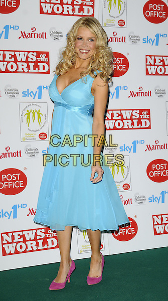 MELINDA MESSENGER.Children's Champions Awards 2009 at the Grosvenor House Hotel, Park Lane, London, England..March 4th 2009.full length blue turquoise dress cleavage pink shoes pointy suede.CAP/CAN.©Can Nguyen/Capital Pictures.