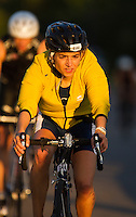 16 AUG 2014 - DARTFORD, GBR - As the sun starts to set Silvina Cives from Serpentine Running Club makes her way round the 2014 Midnight Wo/Man triathlon bike course in The Bridge area in Dartford, Great Britain (PHOTO COPYRIGHT © 2014 NIGEL FARROW, ALL RIGHTS RESERVED)