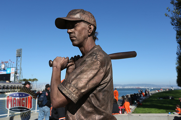 SAN FRANCISCO - OCTOBER 7:  A fans dressed up as a human statue stands outside the ballpark before Game 2 of the NLDS between the Cincinnati Reds and San Francisco Giants at AT&T Park on October 7, 2012 in San Francisco, California. (Photo by Brad Mangin)