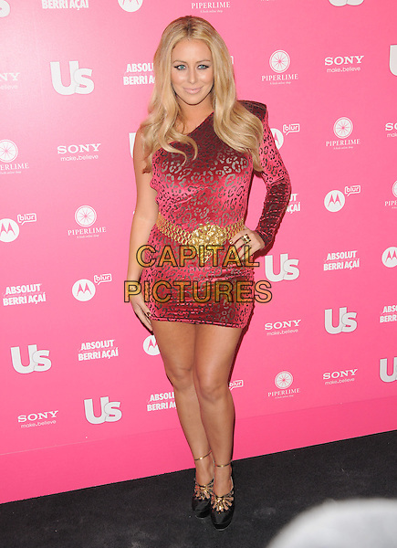 AUBREY O'DAY.The Annual US Weekly Hot Hollywood Style Party at Drai's in Hollywood, California, USA..April 22nd, 2010                                                                    .full length red one shoulder sleeve leopard print belt buckle gold dress hand on hip.CAP/RKE/DVS.©DVS/RockinExposures/Capital Pictures.