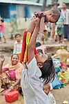 A Rohingya girl, having just crossed the border from Myanmar, lifts her sibling in the Kutupalong Refugee Camp near Cox's Bazar, Bangladesh.<br /> <br /> More than 600,000 Rohingya refugees have fled government-sanctioned violence in Myanmar for safety in this and other camps in Bangladesh.<br /> <br /> Parental consent obtained.