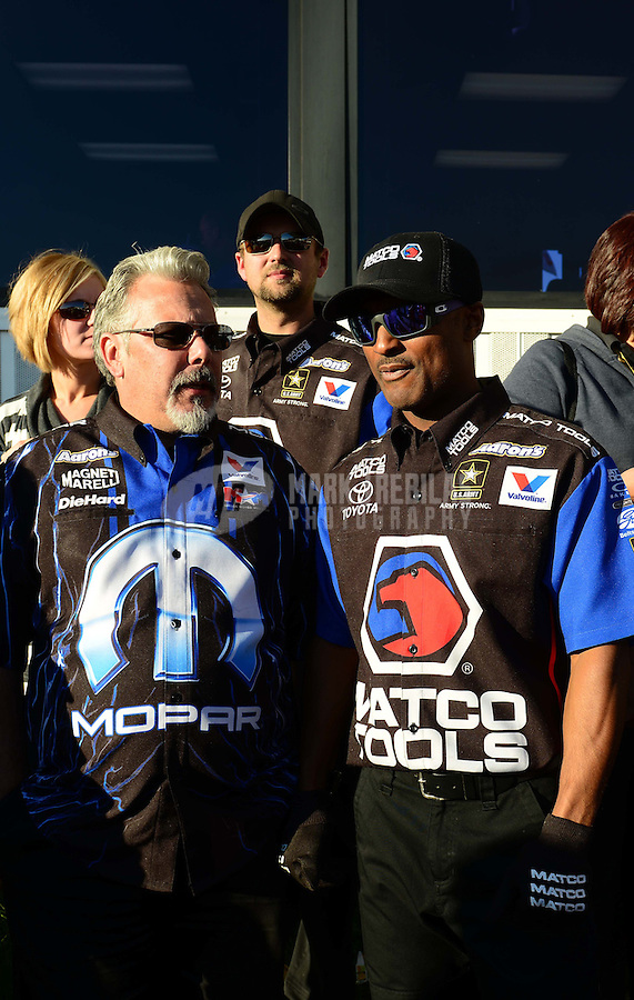 Nov. 11, 2012; Pomona, CA, USA: NHRA top fuel dragster driver Antron Brown (right) with Tommy DeLago during the Auto Club Finals at at Auto Club Raceway at Pomona. Mandatory Credit: Mark J. Rebilas-
