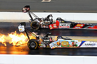 Sep 15, 2013; Charlotte, NC, USA; NHRA top fuel dragster driver Brandon Bernstein (near) has a fire alongside David Grubnic during the Carolina Nationals at zMax Dragway. Mandatory Credit: Mark J. Rebilas-