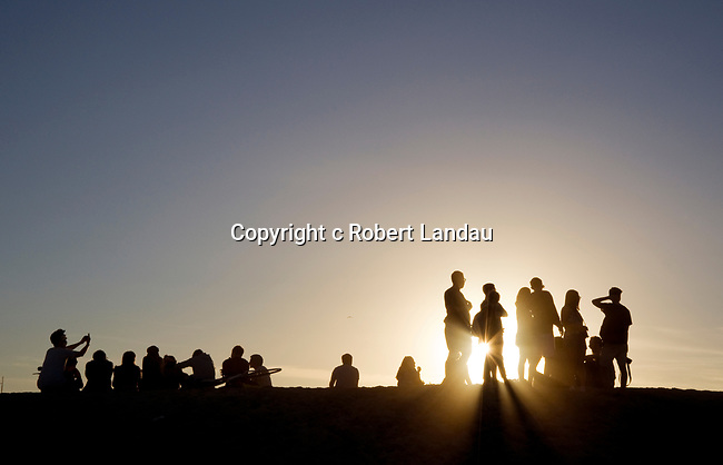 People watching the sunset at Venice Beach