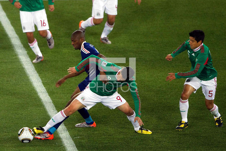 Guillermo Franco of Mexico and Abou Diaby (L) of France
