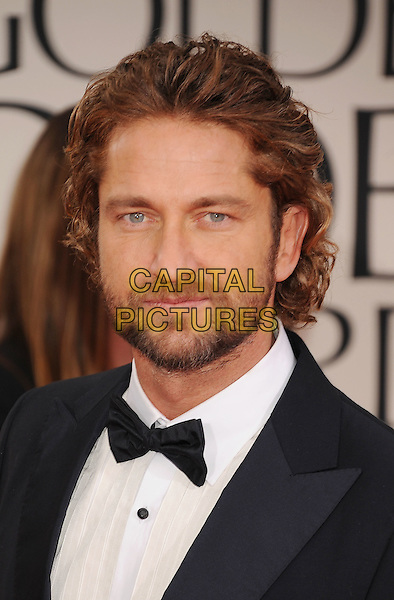Gerard Butler.Arrivals at the 69th Annual Golden Globe Awards at The Beverly Hilton Hotel, Beverly Hills, California, USA..January 15th, 2012.globes headshot portrait black white bow tie beard facial hair .CAP/GDG.©GDG/Capital Pictures