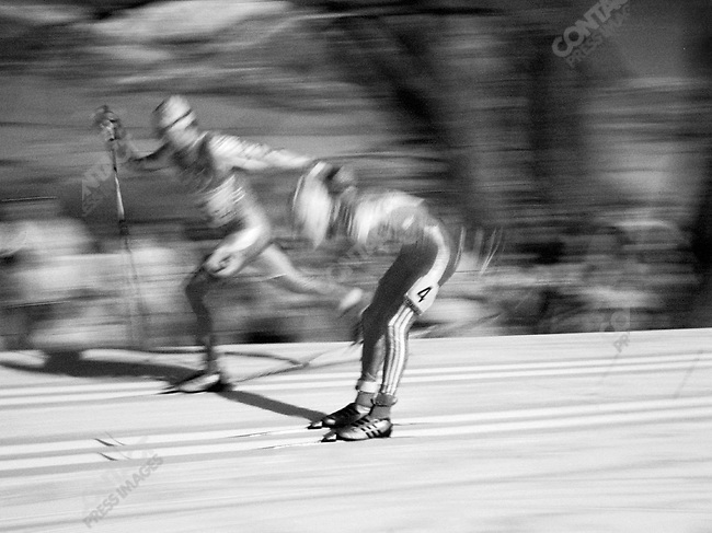 Two skiers race across the flats during the 4 x 7.5 km men's cross-country relay . Soldier Hollow, Utah, USA, February 17, 2002.
