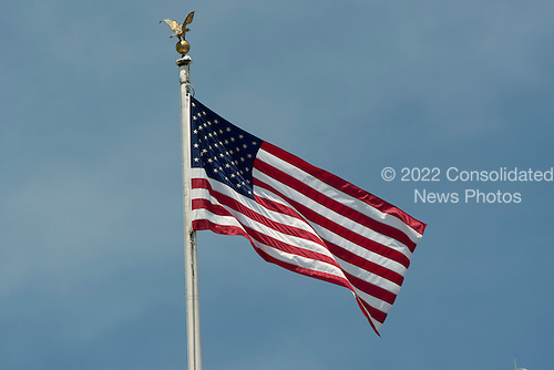 The American Flag on a flagpole on top of the White House in Washington, D.C. on Saturday, May 12, 2012..Credit: Ron Sachs / CNP