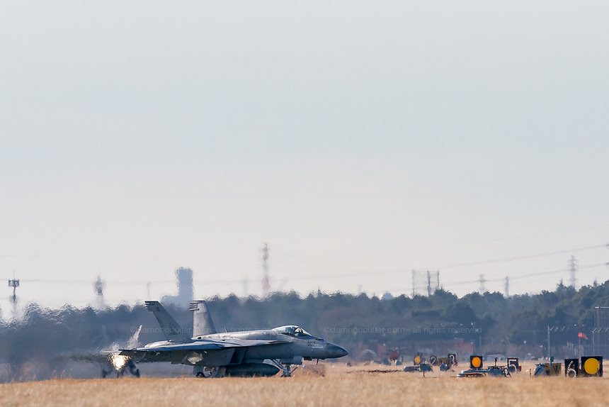 Two F/A18E, Super Hornets of the Strike Fighter Squadron 115 (VFA 115) of the US Navy Carrier Air Wing % taxi to a refuelling stop after landing at Naval Air Facility, Atsugi, Yamato, Kanagawa, Japan. Wednesday January 16th 2019