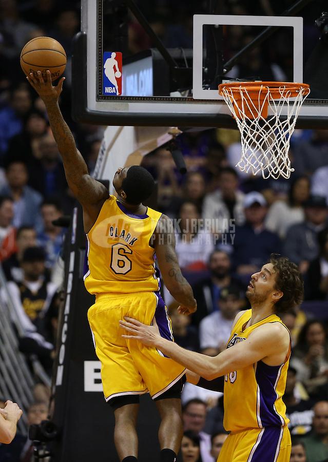 Jan. 30, 2013; Phoenix, AZ, USA: Los Angeles Lakers forward Earl Clark (6) grabs a rebound over Pau Gasol against the Phoenix Suns at the US Airways Center. Mandatory Credit: Mark J. Rebilas-