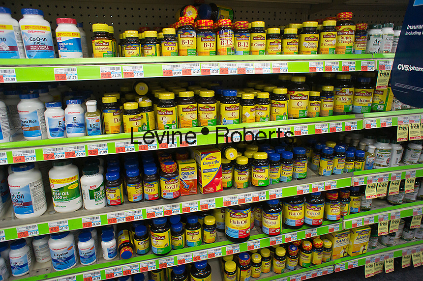 Vitamins and other supplements are seen on the shelves of a drugstore in New York on Friday, October 19, 2012. (© Richard B. Levine)