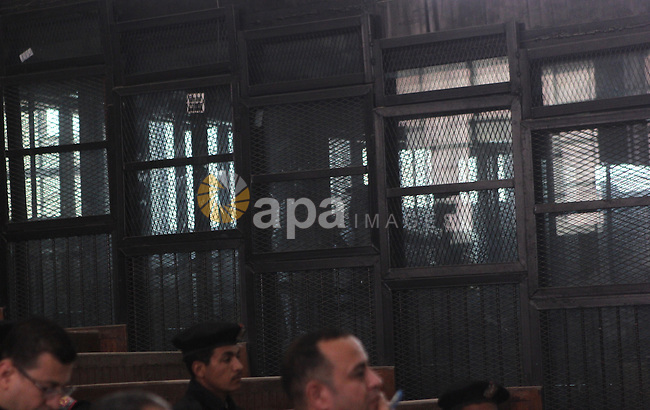 Defendants of the Marriott terror cell case stand in cages in a court, Cairo on March 8, 2015. The court adjourned the retrial of two Al-Jazeera journalists, including Fahmy, freed on bail after more than 400 days in prison, as their colleague Australian Peter Greste, has already been deported. Photo by Amr Sayed