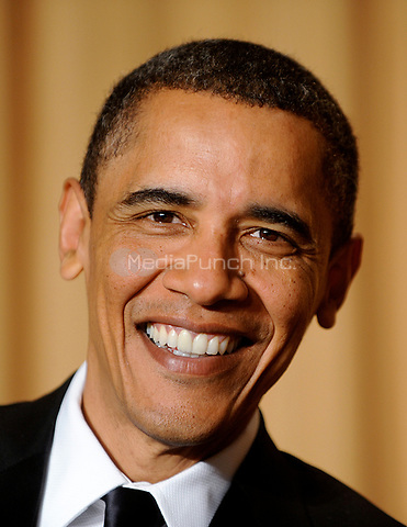 United States President Barack Obama smiles during the White House Correspondents' Association Dinner at the Washington Hilton in Washington, DC, on Saturday, May 1, 2010.<br /> Credit: Olivier Douliery / Pool via CNP /MediaPunch