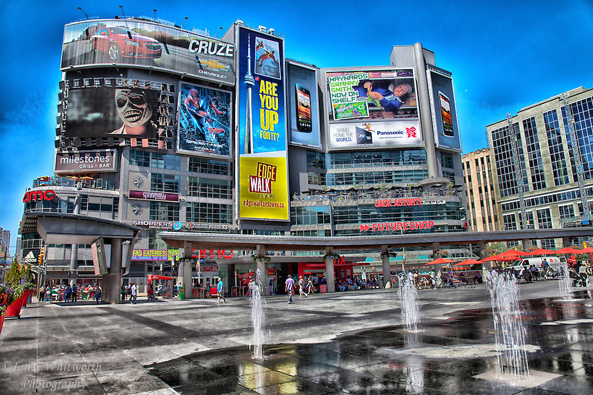 A photo art view of Dundas Square in Toronto.