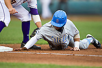UCLA Bruin outfielder Eric Filia (4) is picked off of first base in the first inning of Game 4 of the 2013 Men's College World Series against the LSU Tigers on June 16, 2013 at TD Ameritrade Park in Omaha, Nebraska. UCLA defeated LSU 2-1. (Andrew Woolley/Four Seam Images)